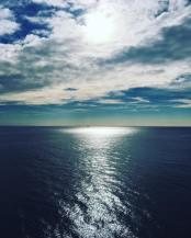 Drinking Estrella overlooking the sea